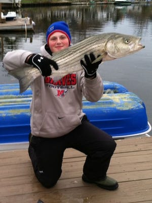 Nick Amrani. 16, from Manalapan, got his first striped bass on a plug fishing off Sandy Hook.