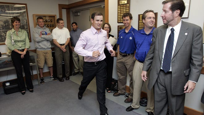 PGA golfer and former Drake student Zach Johnson strides into the room before a Drake University press conference with Drake president Dr. David Maxwell, right, on May 23, 2007.