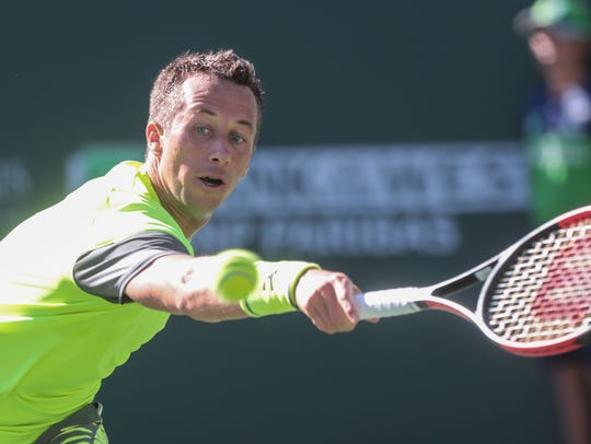 Philipp Kohlschreiber, of Germany, gets his raqucet