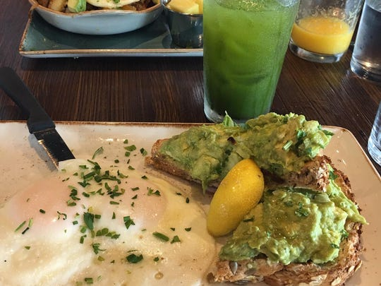 Avocado toast served with two eggs.