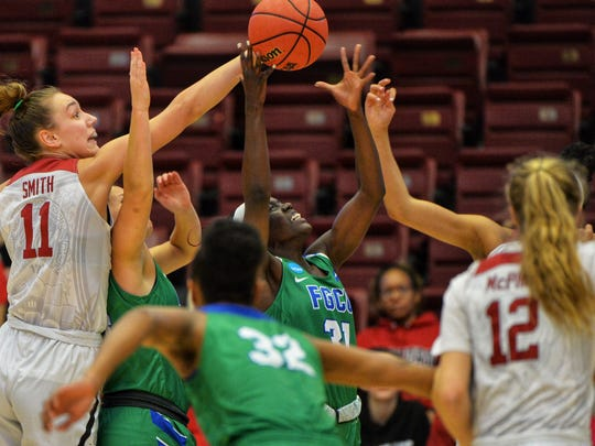 Florida Gulf Coast University's Nasrin Ulel (center) grabs the rebound during the second round against the Stanford Cardinal in an NCAA women's basketball game at Maples Pavilion at Stanford University on Monday. The Eagles lost, 90-70.