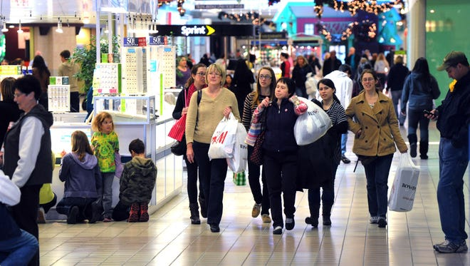 Consumer spending was weak in May, prompting economists to lower their growth forecasts.(AP, Sue Beyer)