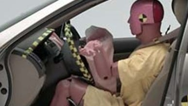 A crash test dummy is used for a Honda Accord crash test by the Insurance Institute for Highway Safety. Honda is biggest U.S. buyer of Takata air bags and has recalled more than any of the 10 car companies affected by potential Takata defect.
