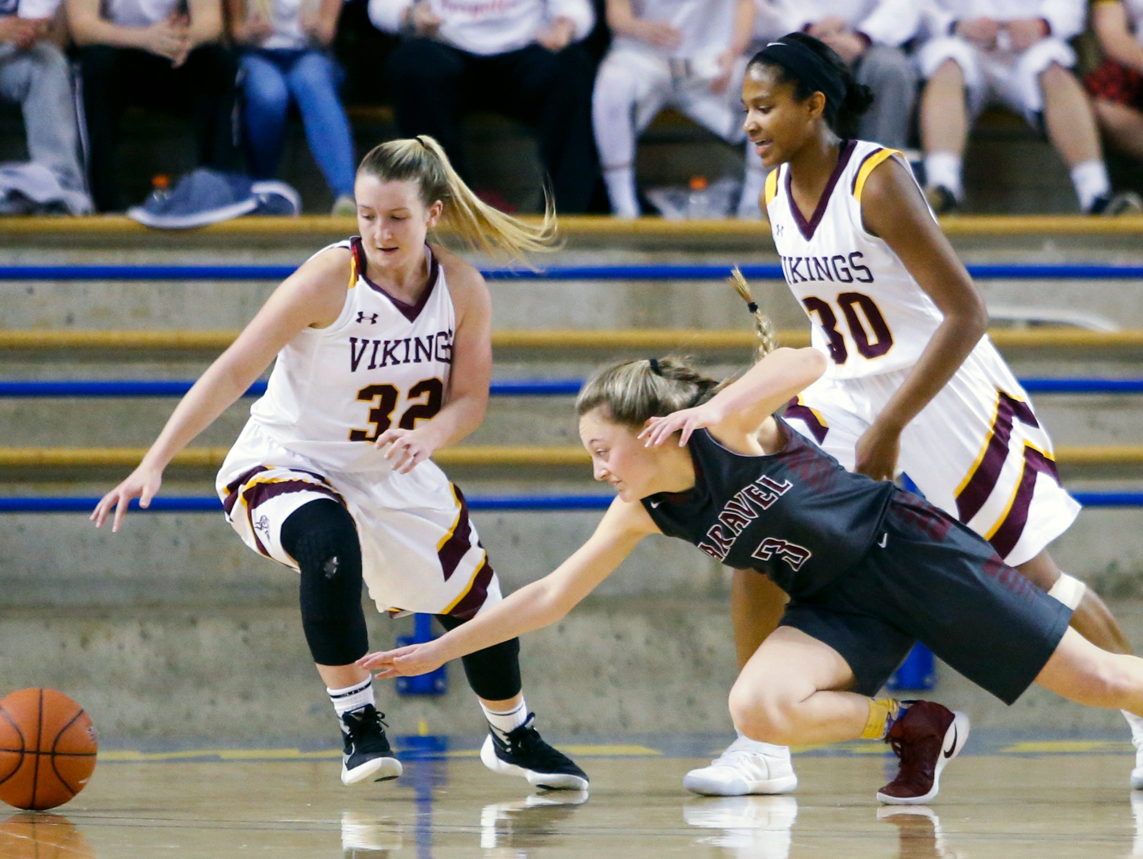 Caravel's Karli Cauley (3) moves for a loose ball between St. Elizabeth's Alexis Bromwell (left) and Alanna Speaks in the second half of Caravel's win in a DIAA state tournament semifinal Wednesday at the Bob Carpenter Center.
