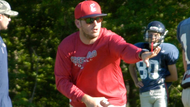 Creek Wood head coach Houston Thiel gives instructions on a play during spring practice