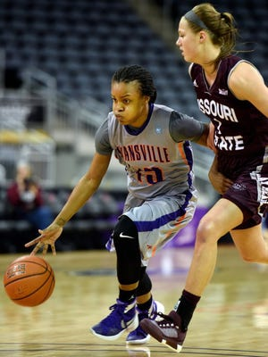 MIKE LAWRENCE / COURIER & PRESS      University of Evansville's Kenyia Johnson drives around Missouri State's Danielle Gitzen during Sunday's game at the Ford Center, February 21, 2106.