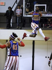 A Harlem Globetrotters' jumps through the hoop during the Globetrotters' show Feb. 9, 2016, at Moody Coliseum. The famed basketball troupe is back in Abilene on Sunday.