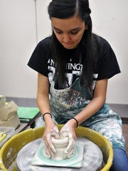 In this file photo, ceramics student Taylor Everett begins shaping a bowl from stoneware clay during class at Midwestern State University for the 5th Annual Empty Bowls event. This year's event will be Oct. 15. at the Wichita Falls Museum of Art at MSU.