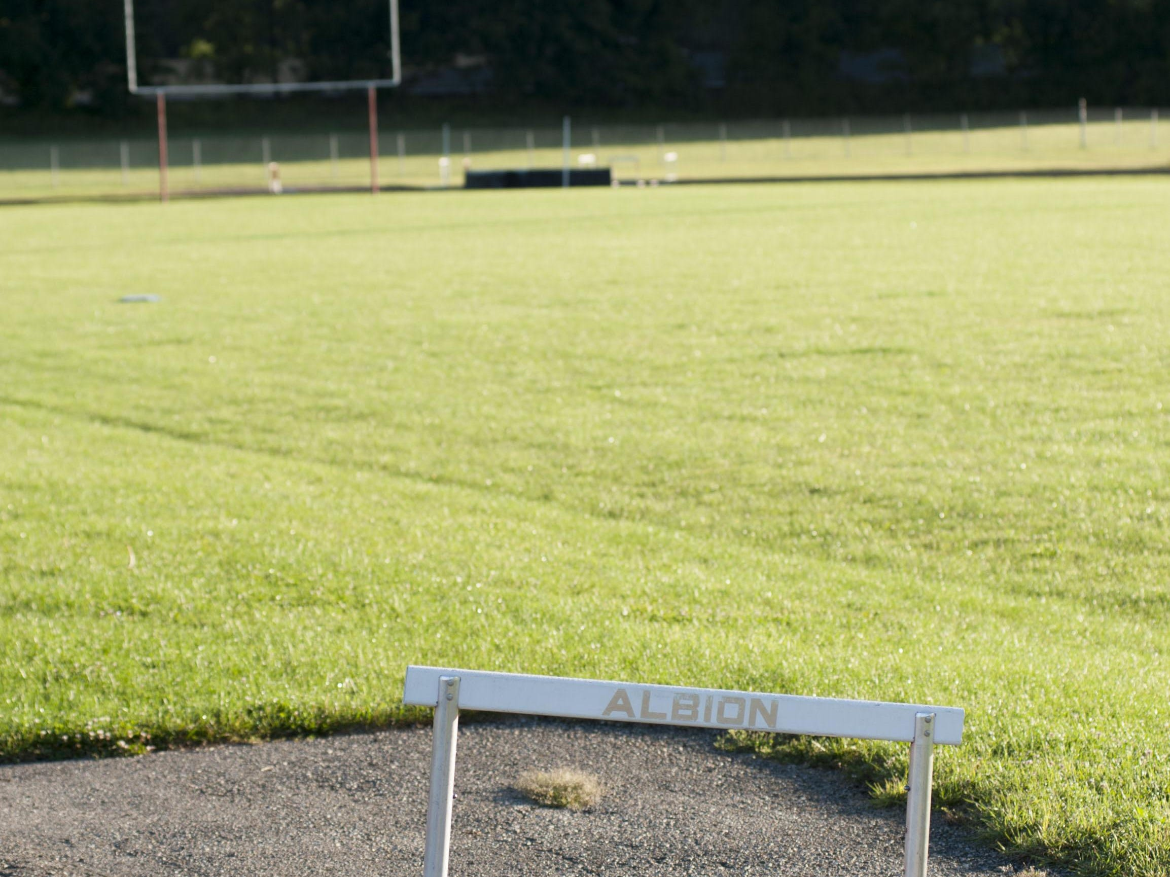 Albion High School's football field sits empty after the school closed its doors in 2013.