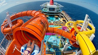 The orange Kaleid-O-Slide is part of the WaterWorks fun zone atop cruise giant Carnival's new Carnival Vista.