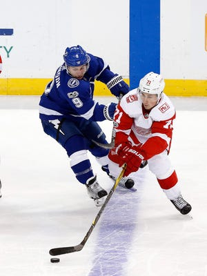 Red Wings center Dylan Larkin (71) skates with the puck as Lightning center Tyler Johnson (9) defends during the first period on Thursday, Oct. 26, 2017, in Tampa, Fla.