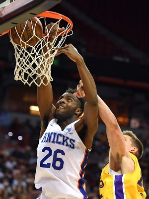 July 10: Knicks center Mitchell Robinson (26) throws down a dunk against the Lakers.