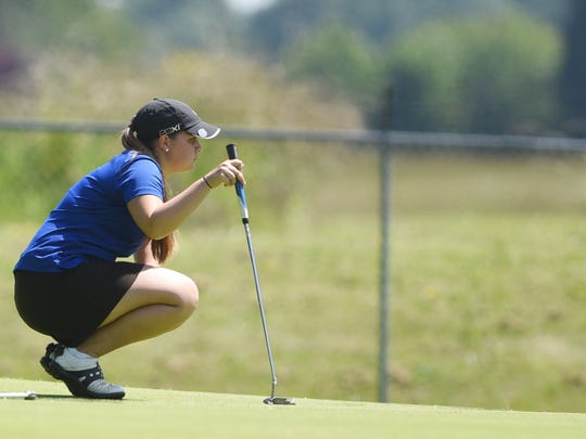 McNary's Cammie Decker prepares to putt during the first day of the OSAA 6A state golf tournament on Monday, May 18, 2015, at Trysting Tree Golf Club in Corvallis.
