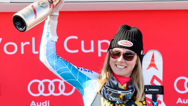 Mikaela Shiffrin celebrates on the podium after winning the Women's Slalom race at the FIS Alpine Skiing World Cup Finals in St. Moritz, Switzerland.