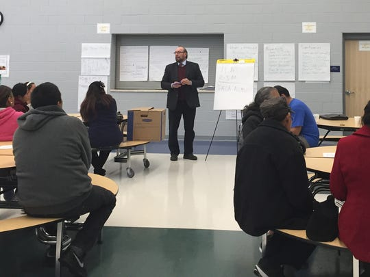 Diego Bonesatti, director of legal services at Michigan United, talks to immigrants on Nov. 19, 2016, at Hope of Detroit Academy about their rights and concerns under a Donald Trump presidency.