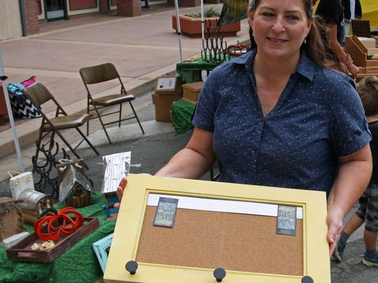 Anne Marie Glomson, wood shop instructor at Washington Middle School, shows off a message board coat rack built in her shop