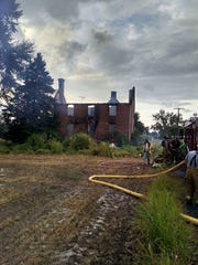A fire gutted a house near the Cedar Swamp Wildlife Area on Wednesday, July 15, 2015.
