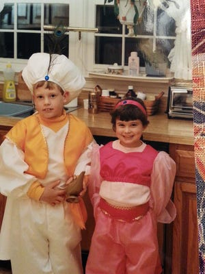 My brother, Chris Peters, and myself dressed up for Halloween in the 1990s as Aladdin and Princess Jasmine, all pink instead of blue of course. Costumes handmade by my mom.