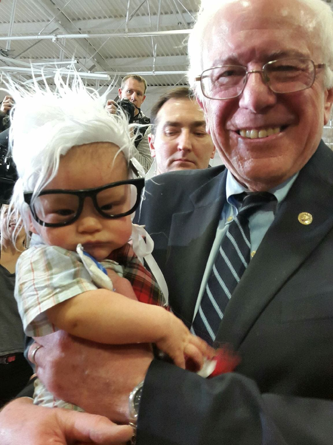 Oliver Lomas with presidential hopeful  Bernie Sanders in February.