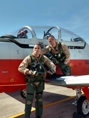 Twin brothers Matteo and Andy Occhipinti, both Marines, graduated from flight training together at Naval Air Station Whiting Field.
