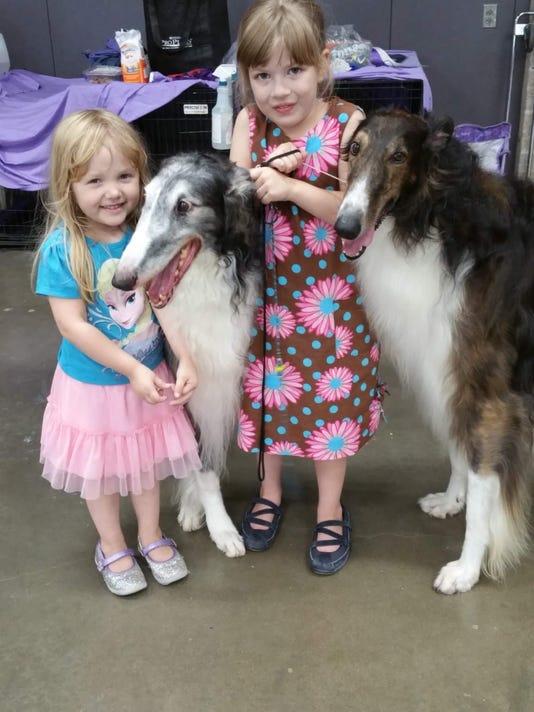 636217286535995246-Kari-McCloskey-photo-of-daugher-Raina-and-dog-Briar.jpg