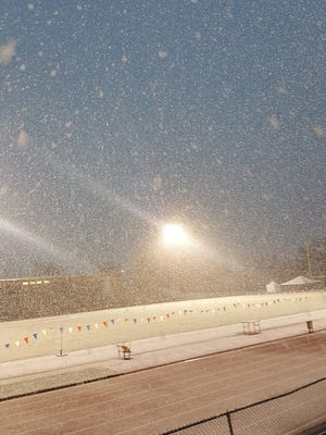 Snow hit Jeffco Stadium on Thursday morning, forcing a postponement of the first day of the state track and field meet.