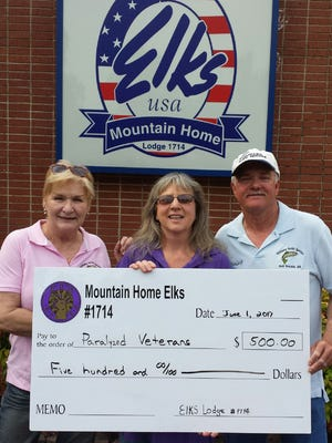 Mountain Home Elks Lodge 1714 donated $500 to help sponsor the fifth annual White River fishing trip for Paralyzed Veterans of America members. Funding for the donation came from Elks Veterans Golf Tournament proceeds.Shown arePat Curtis, event organizer, from left; Lisa Houser, Elks Benevolence chairman; and Tim Curtis, event organizer.