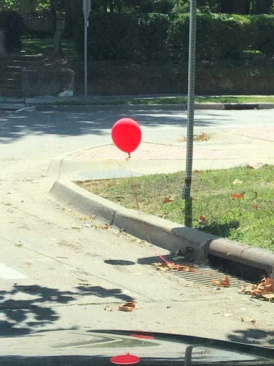 It Inspired Red Balloon Tied To Des Moines Sewer Grate