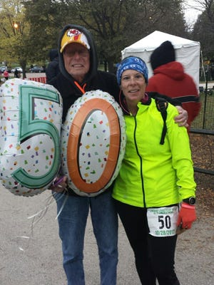 Michele Cox of Howell with her dad, Bill Soltys, following her completion of the Chicago Lakefront 50/50 Ultramarathon on Oct. 28, the day before her 50th birthday, and her 50th race this year.