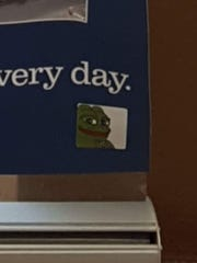 The Pepe the Frog sticker on a poster at MCC.