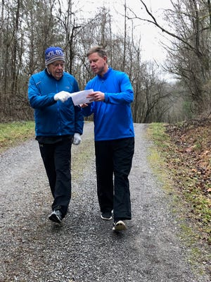 Todd Howell, right, and Wilson Ritchie compare notes during a recent training run for the Knoxville Marathon.