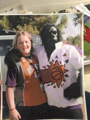 Navey Baker poses with the Phoenix Suns gorilla during