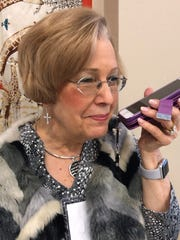 Rita Vokes calls friends to encourage them to shop the Faith Fashion Boutique sale, which benefited Faith Refuge. Vokes, a retired Air Force colonel, garnered public recognition from U.S. Sen. Ted Cruz during a campaign stop earlier this year in Wichita Falls.
