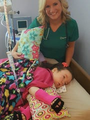 Sparrow nurse Kelli Kilmon with Olivia Borodychuk,