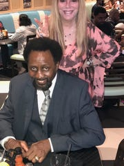 """Tommy """"Hitman"""" Hearns and Jackie Kallen (standing)"""