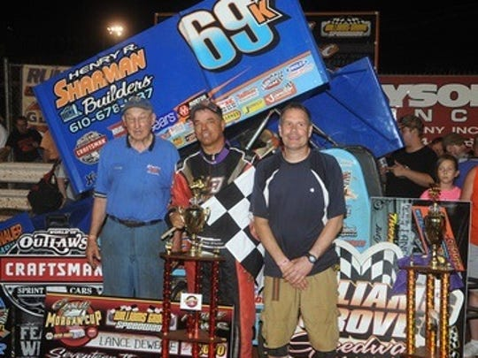 Fayetteville driver Lance Dewease, center, poses in victory lane with teammates Davey Brown, left, and Donnie Kreitz Jr. after winning the 410 Sprint Summer Nationals feature at Williams Grove on Saturday night.