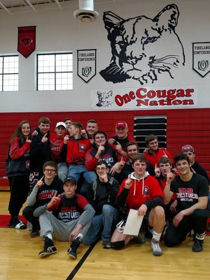 The Crestview Cougars celebrate their repeat Firelands Conference wrestling championship.