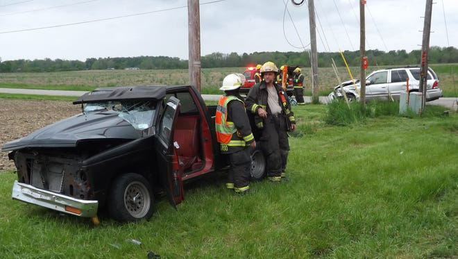 Two damaged vehicles sat on the south side of U.S. 40 east of Hildebrand Road after an accident Thursday, May 12, 2016.