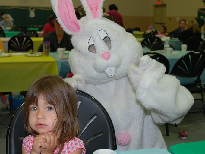 Airyn Nichole poses with the Easter Bunny during the