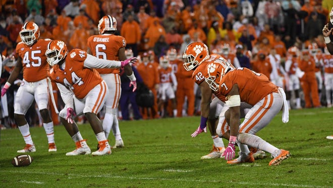 Clemson defensive linemen Austin Bryant (7), Christian Wilkins (42) and Nyles Pinckney (44) dance on the line of scrimmage during a timeout during the Tigers' game against Georgia Tech on October 28, 2017.