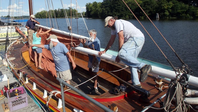 Members of the Beacon Sloop Club work on the the sloop Woody Guthrie, while docked in the Rondout Creek in Kingston Aug. 24,  2017. The sloop Woody Guthrie is owned by the Beacon Sloop Club. Both are closely linked to Clearwater and Pete Seeger.
