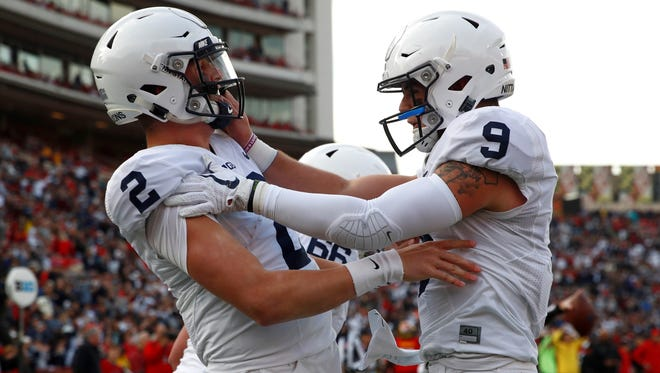 Penn State quarterback Tommy Stevens, left, celebrates his touchdown with fellow quarterback Trace McSorley against Maryland last season. Stevens is expected to again back up McSorley in 2018 before becoming the team's likely starter in 2019. AP FILE PHOTO