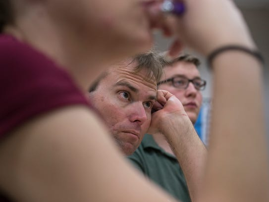 Matt Brodt (center) listens during professional development