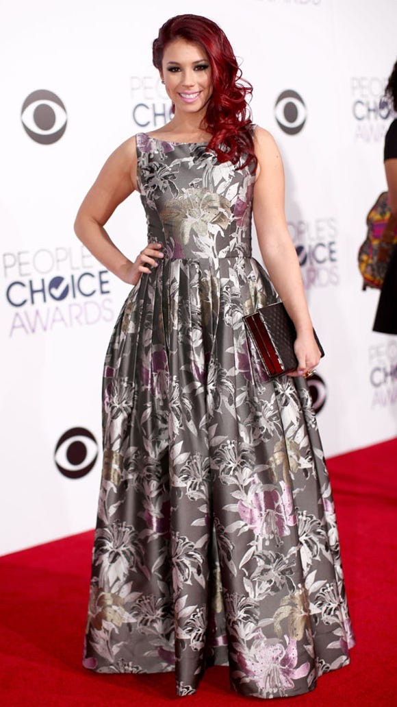 Jillian Rose Reed in metallic floral frock.