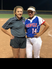 Tayler Lopez, left, was on the Las Cruces High 2013 state championship team and an assistant on this year's team that was coached by her father, Alex Lopez, with her younger sister, Samantha Lopez, playing left field.