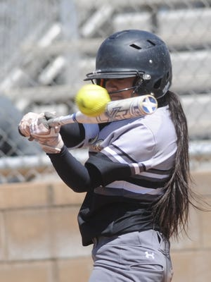 Lubbock High's Gabby Flores hits the ball in the fourth inning against Cooper. The hit went for an inside-the-park home run to center field, driving in two runs for a 13-3 lead. The Lady Westerners won the game 15-4 in five innings Saturday, April 14, 2018 at Cougar Diamond.