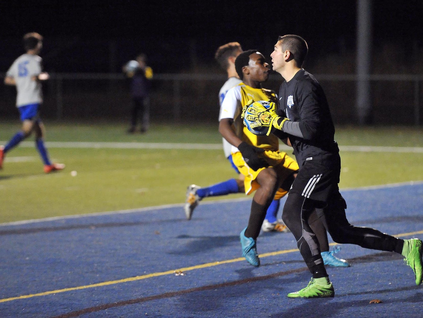 Holmdel goalkeeper Tyler Marchiano (right) makes a save against Delran in their Group 2 boys' soccer semifinal, Tuesday, Nov. 17 in Buena Vista.