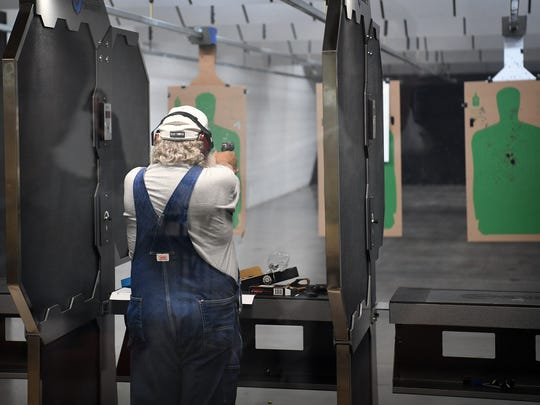 A customer shoots on the 10-station, 25-yard shooting range at High Caliber Indoor Gun Range. The business is located on I-44 just north of the city limits.