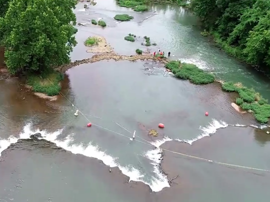 A drone camera view of the section of the Spring River that's been marked by buoys and tape to keep paddlers away from a dangerous whirlpool.