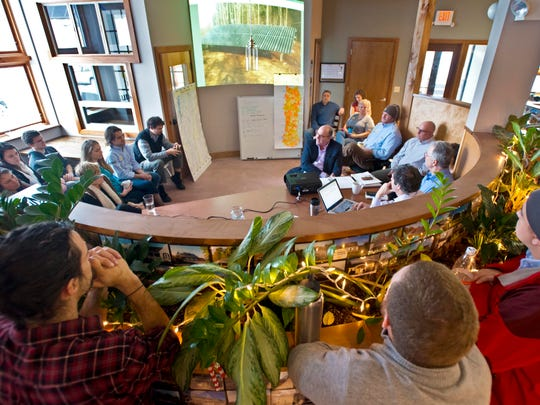 SunCommon employees gather for the company's weekly Monday morning staff meeting in Waterbury on Monday, December 15, 2014.